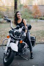 Young Beautiful Biker Woman In...