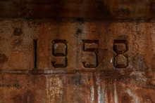 Close-up Of Number 1958 On Old Concrete Wall