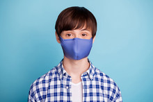 Portrait Of Charming Boy Looking Hear Stay Home Covid-19 Quarantine News Wearing Breathing Mask Checked Shirt Isolated Over Blue Background