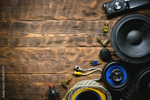 A new car audio equipment on brown wooden workbench background with copy space Canvas Print