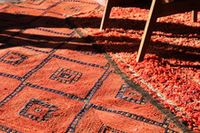 High Angle View Of Red Rug On Sunny Day