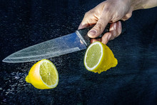 Cutting A Lemon With A Knife