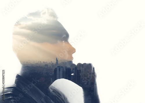 Obraz Double exposure portrait of a man in contemplation at sunset time above the city - fototapety do salonu
