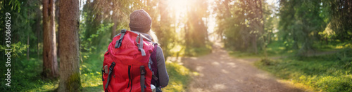Obraz Young woman hiking and going camping in nature - fototapety do salonu