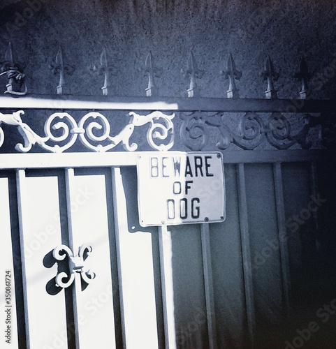 Beware Of Dog Sign On Gate Wallpaper Mural