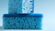 Two Blue Sponges Used For Wash...