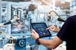 canvas print picture - Smart industry control concept.Hands holding tablet on blurred automation machine as background