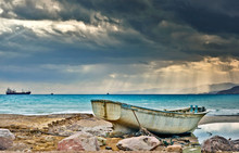 Old Abandoned Fishing Boat On The Beach