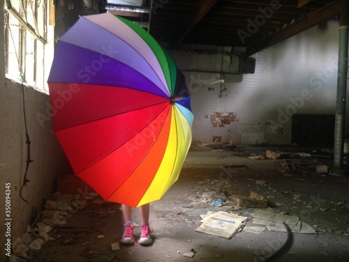 Fototapeta Person Behind Umbrella Standing In Abandoned Building obraz