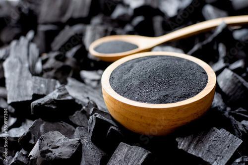Charcoal is crushed and put into a large cup of charcoal. Wallpaper Mural