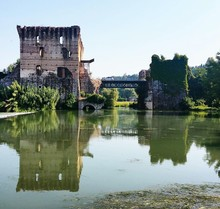 Visconti Bridge Valeggio By River Against Sky