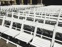 Close-up Of Empty Chairs In Rows
