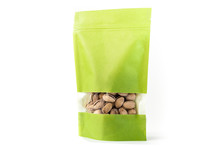 Green Paper Standup Pouch Filled With Dry Fruit, Flexible Packaging With Window Zipper On White Background