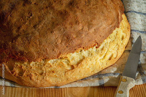Sliced bread and anointed butter lie on the table. Wallpaper Mural