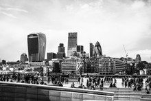 Crowd By 30 St Mary Axe Against Sky In City