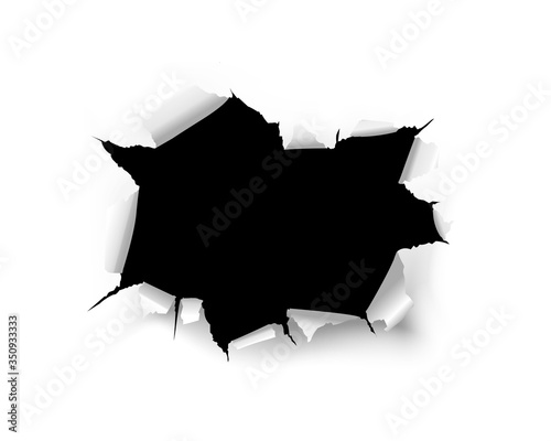 Fotografia Torn black hole on a white background of a paper sheet
