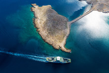 Top View Of  Car Ferry In Croatia. View Of The Island Rab, On The Route Between Stinica And Misnjak. On This Side The Island Is Rocky With Sparse Vegetation. South Europe