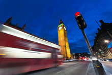 Blurred Motion Of Double-decker Bus By Illuminated Big Ben In City At Night