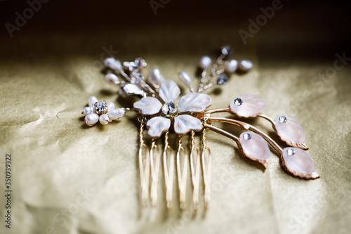 Gold hair ornament. Inlaid artificial crystals. Fototapeta