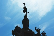 Low Angle View Of Statue Blue Sky