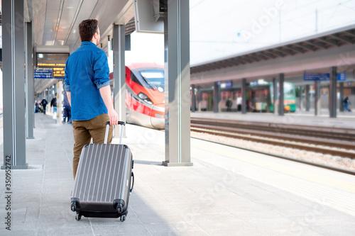 Obraz Portrait of caucasian male in railway train station - fototapety do salonu