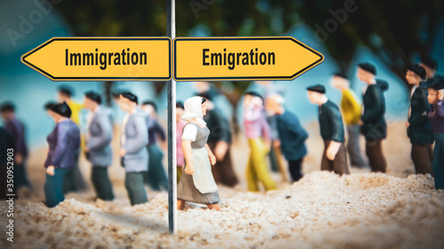 Photo Street Sign Emigration versus Immigration