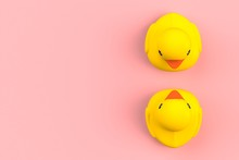 Close Up Of Two Rubber Ducks Isolated. Bath Toys On A Pink Background. Top View With Copy Space. Summer Wallpaper. 3d Rendering.
