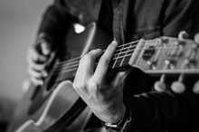 Guitar Player Chords Close Up On The Strings - Black And White, Selective Focus.