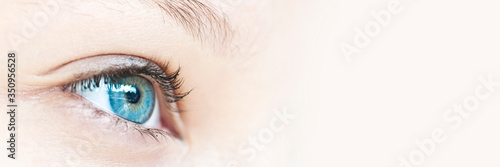 Obraz Close up on a girl blue eye, panoramic web banner with copy space - fototapety do salonu