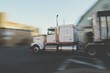 Side View Of A Blurred Cropped Truck On Street