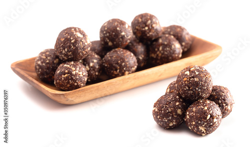 Fototapeta Chocolate Energy Protien Balls Made of Raw Organic Nuts and Dates on a White Background obraz
