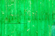 canvas print picture - Wooden boards on an old green fence as an abstract background.
