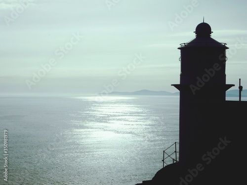 Photo Silhouette Lighthouse At Bantry Bay