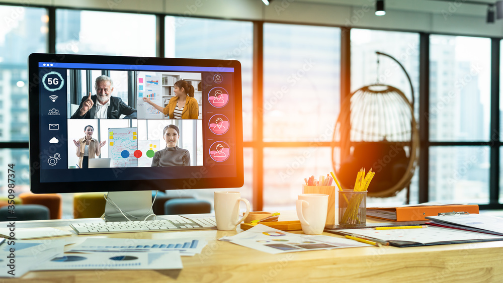Fototapeta Businesswoman and Business team in video conference for protection covid-19.woman watching laptop webinar video course at home office.Webinar,social distancing,e learning and seminar online Concept.