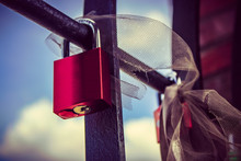 Close-up Of Padlock On Railing Against The Sky