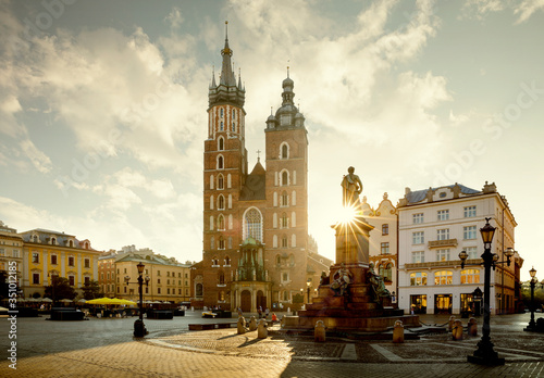 Fototapeta Cityscape of Krakow town square with Adam Mickiewicz monument and St. Mary's Basilica, Poland obraz