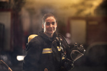 Female Firefighter Portrait We...