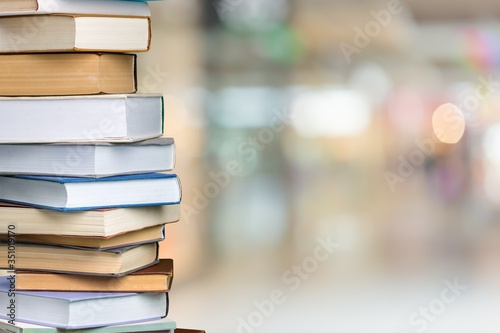 Collection of old books stack on blur background Fototapeta