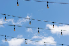 Hanging Bulbs On Wires Over The Area. Decoration Bare Vintage Lamps.
