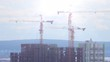 Cranes on construction site, timelapse