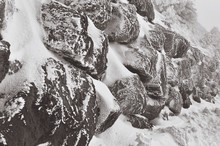 Close-up Of Snow Covered Rocks