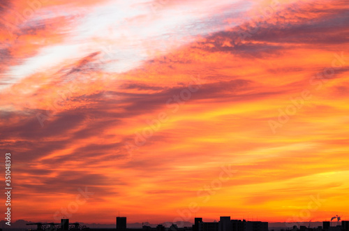 Fototapety, obrazy: Silhouette Buildings Against Dramatic Sky During Sunset