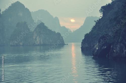Fotografie, Obraz View Of Calm Sea Against Rocky Mountain