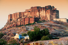Low Angle View Of Mehrangarh Fort Against Clear Sky During Sunset