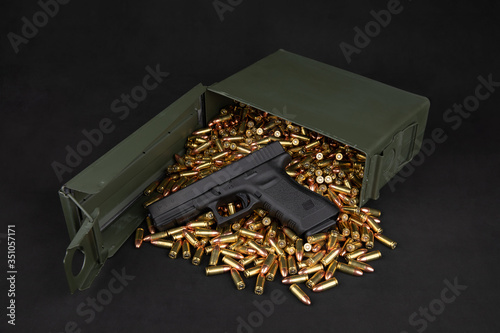 Photo Glock 17 with 9mm ammo & ammo box