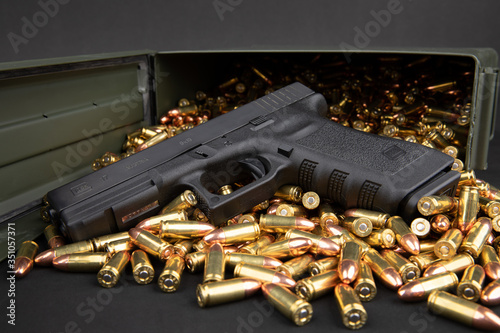 Glock 17 with 9mm ammo & ammo box Wallpaper Mural