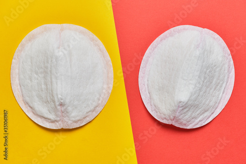 Obraz Women pad for bra on a yellow and red background. - fototapety do salonu