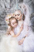 Close Up Portrait Of Two Little Sisters. Winter And Summer. Two Beautiful Sleeping Girl In Snow. A Meeting Of Winter And Summer Sisters. Professional Makeup. Beautiful Face Painting