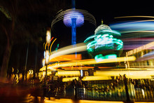 Blurred Motion Of Illuminated Amusement Park Ride At Night