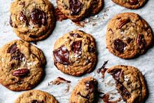 Chocolate Chip Pecan Cookies With Flaky Salt Closeup.